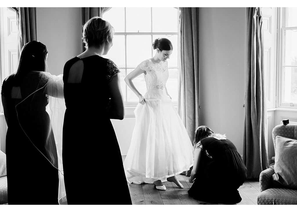 bride bridesmaids preparation wedding dress Essex Chelmsford photographer