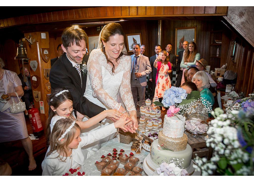 cutting the wedding cake photograph