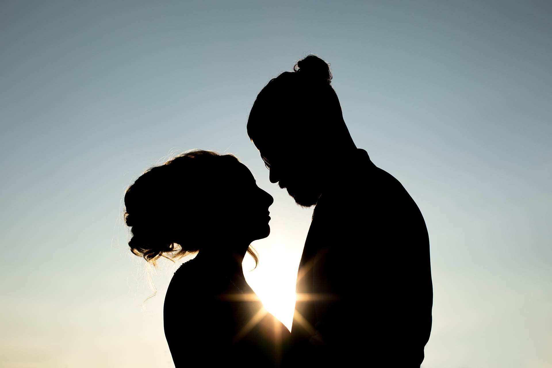 Silhouette of bride and groom photograph by Eyeshine Photography