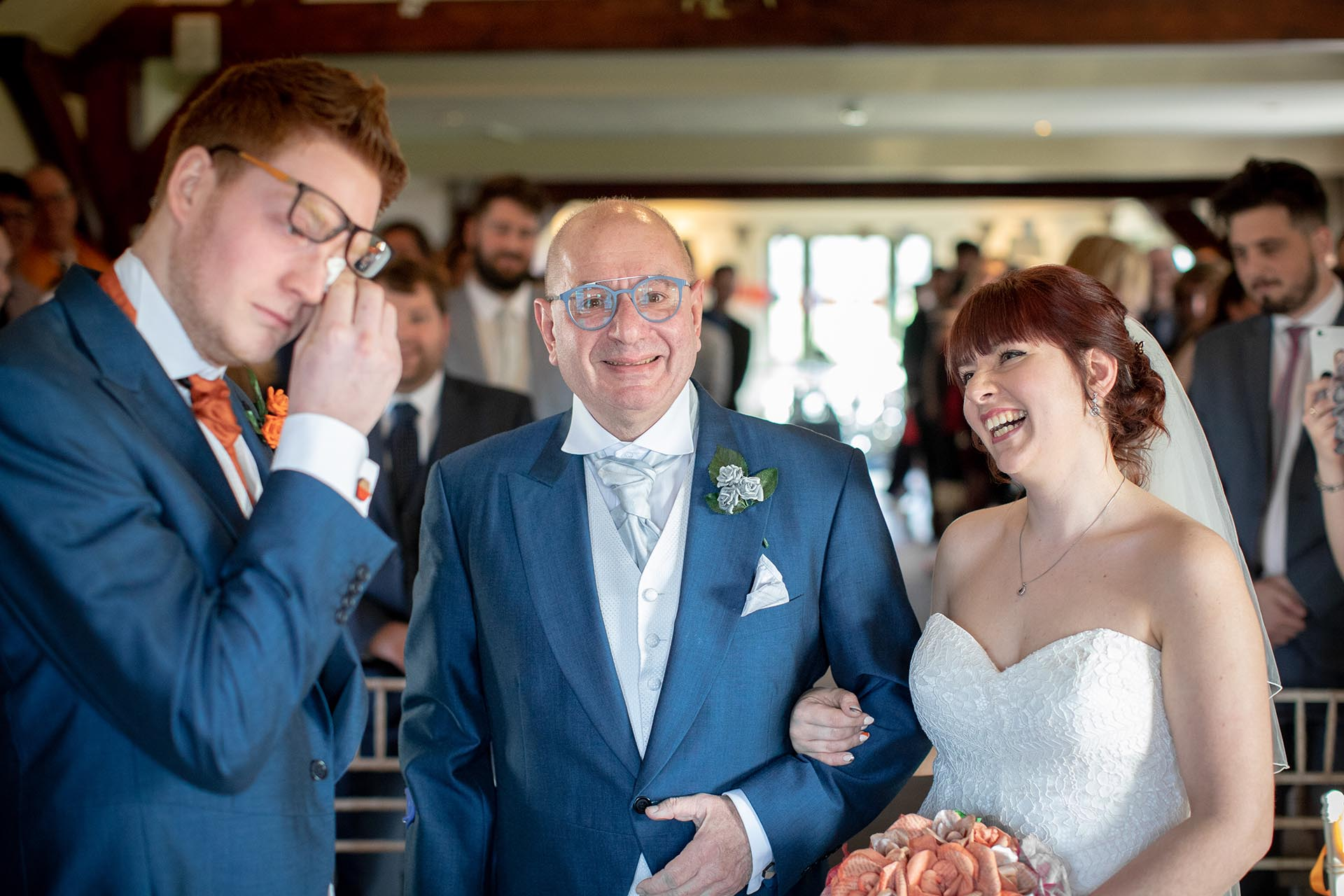Reportage Essex wedding photography showing an emotional groom