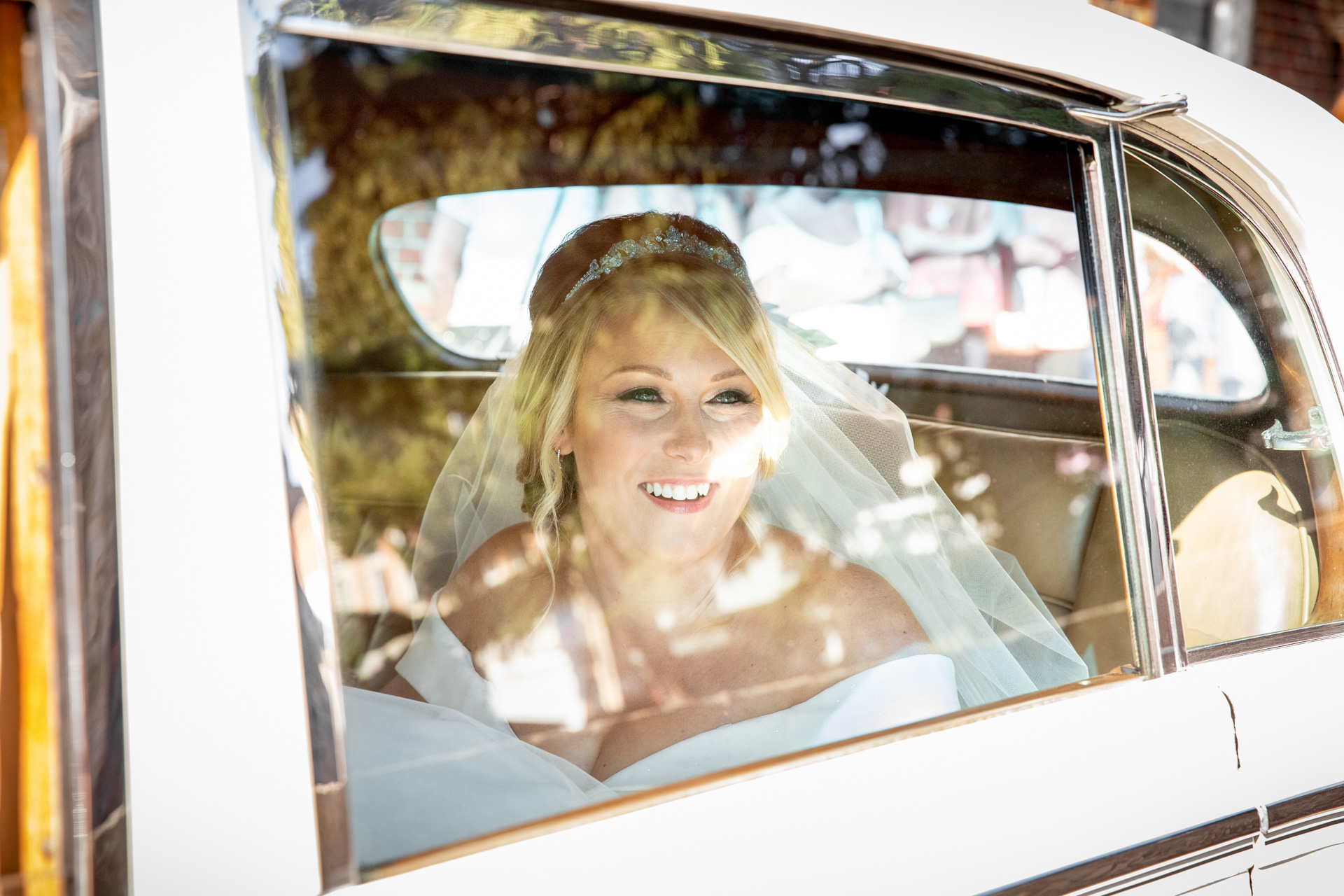Wedding reportage photograph of bride arriving at church in Leigh-on-Sea Essex