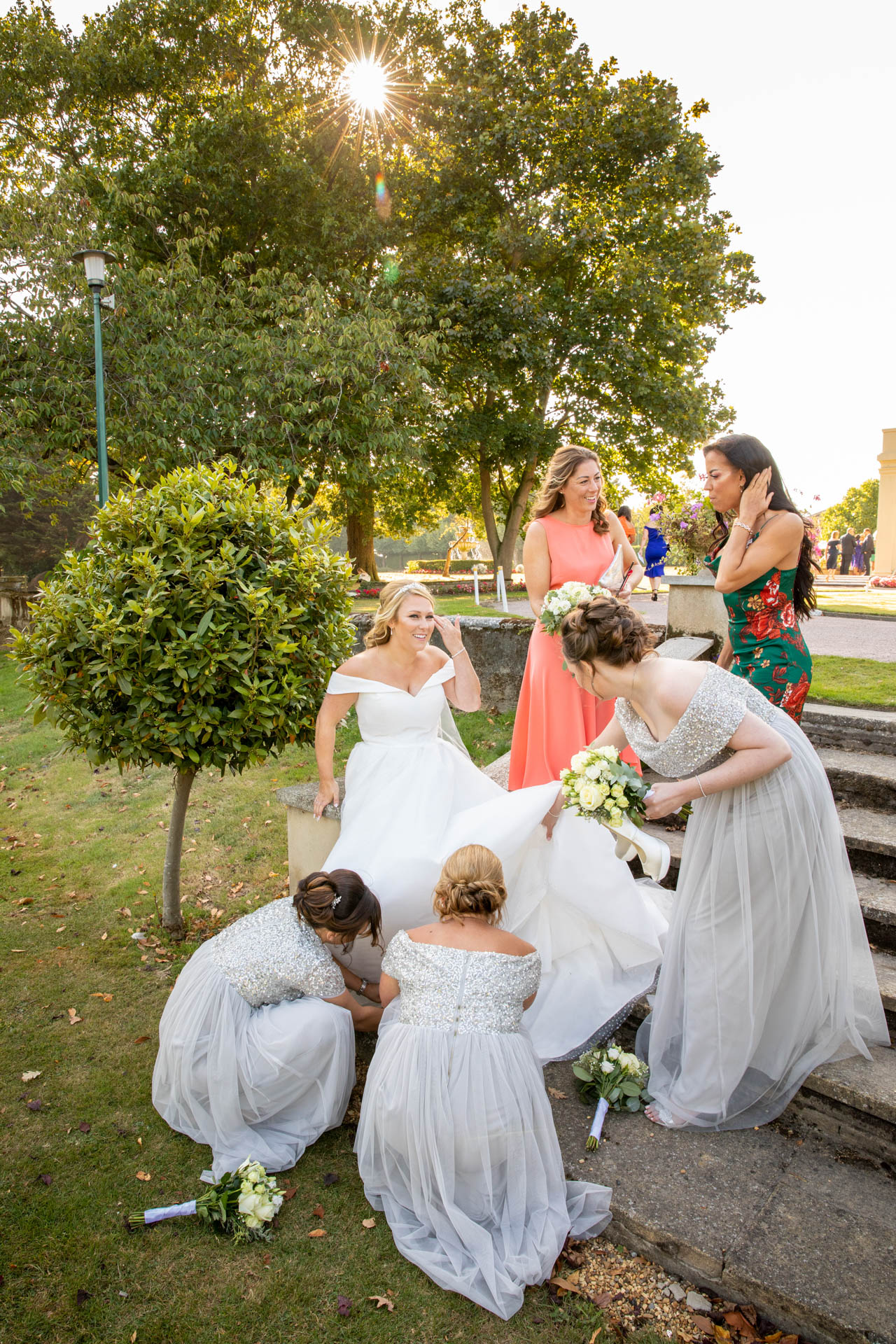 Wedding reception reportage photograph of bride and bridesmaids at The Lawn Rochford Essex