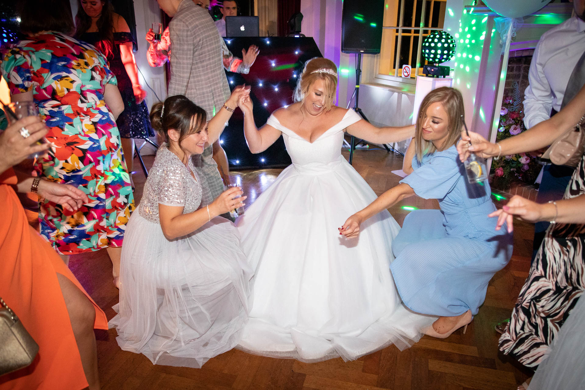 Wedding reportage photography of bride dancing with friends at The Lawn Rochford Essex